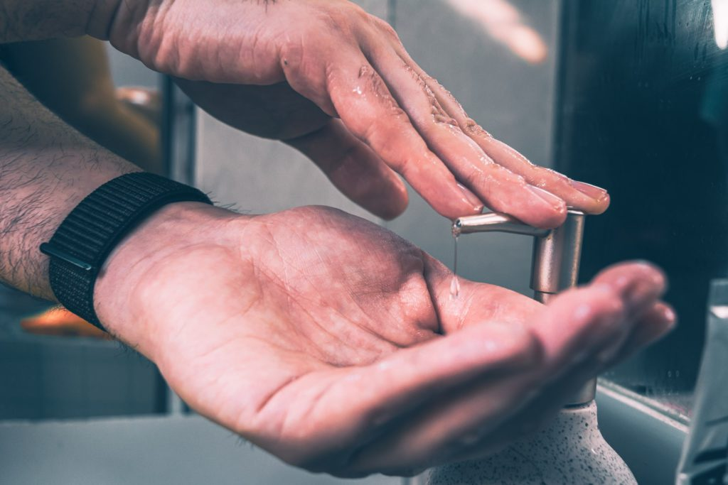 A person applying soap to their hands.